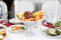 Dish with fresh fruit on the Banquet table in the restaurant