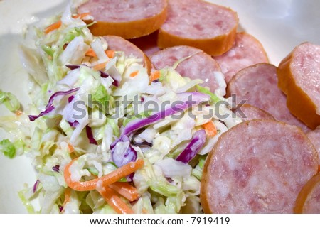 Dish with sausage and cold slaw