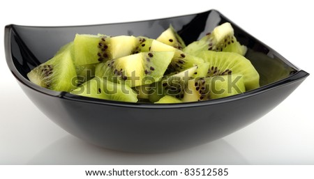 dish with sliced kiwi fruit on white background