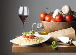 dish with spaghetti and ingredients on the wooden table