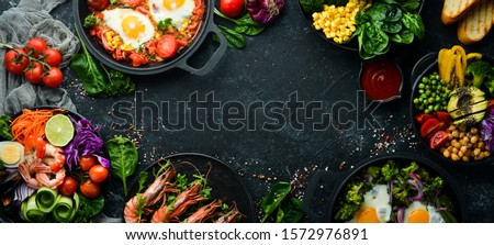 Dishes background. Set of dishes on the dining table. Food. Traditional cuisines of the world. Top view. Free space for your text.