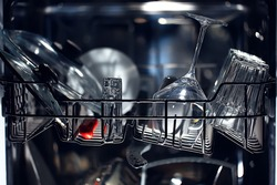 dishes in an open dishwasher, home style lifestyle, cleanliness and convenience background