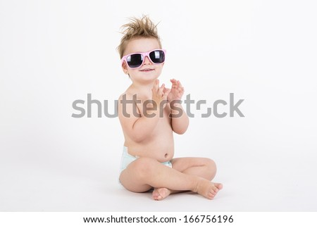 disheveled girl smiling wearing sunglasses with withe background #166756196