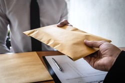 Dishonest cheating in business illegal money, Businessman receive bribe money in envelope to business people to give success the deal contract of investment, Bribery and corruption concept.