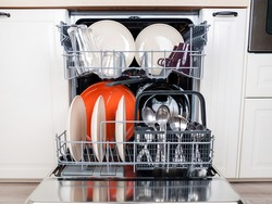 dishwasher close-up with washed dishes, easy to use and save water, eco-friendly, built-in kitchen dish washing machine