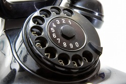 Disk dialer of old vintage black phone close-up