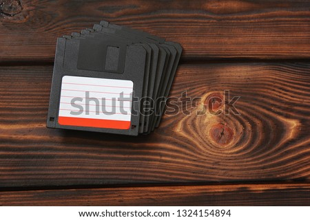 Diskettes on wooden background