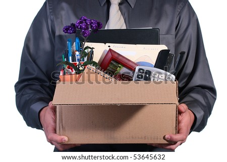 Dismissal, the man has control over a cardboard box with personal office things.