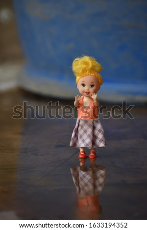 Disneyland, Ca, Usa- A cute Barbie doll walking on the water, a doll hands up.