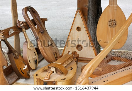Display of ancient string musical instruments #1516437944