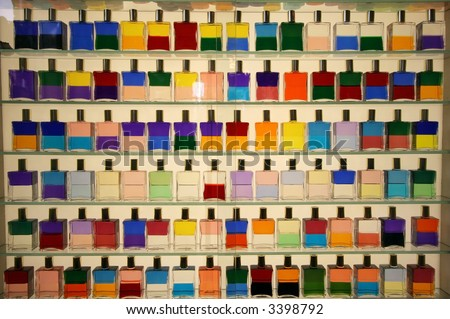 display of bottles with different colored liquids