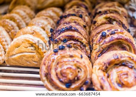 Display of chocolate chip pastries and honey buns macro closeup #663687454
