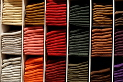 Display of colorful socks in a Uniqlo store in Rennes, France. Uniqlo is a Japanese clothes retailer.