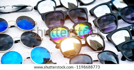 Display of colorful sunglasses for sale. #1198688773