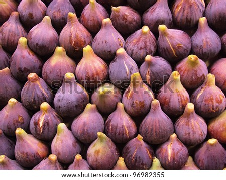 Display of fresh figs at a fruit market. Can be used as a healthy food background.