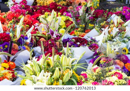 Display of fresh flower arrangements at the farmers market