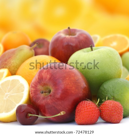 Display of fresh fruit on brightly coloured background