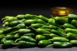 Display of Padron Tapas Peppers Pimientos de Padron on Slate Background