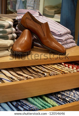 stock photo : Display of shoes and neckties in modern upscale men's clothing ...