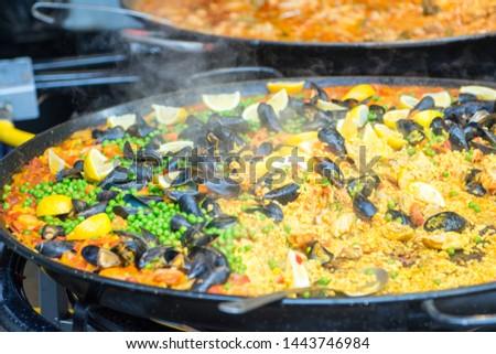 Display of steaming hot paella at local artisan market