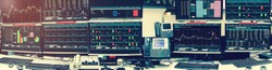 Display of Stock market quotes and chart in monitor computer room with business office equipments .business and money concept, panorama with grainy style.