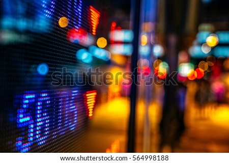 Display of Stock market quotes with city scene reflect on glass #564998188
