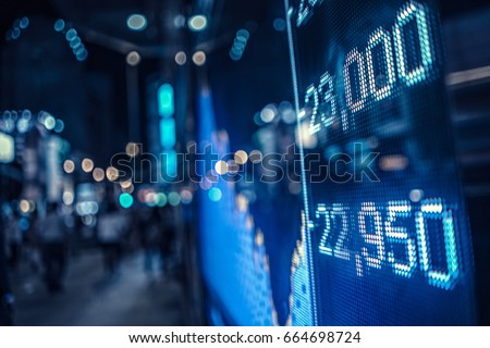 Display of Stock market quotes with city scene reflect on glass #664698724