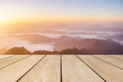 Display old wood bridge shelves on blurred mountain and foggy landscape and beautiful sunrise natural background.
