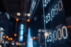 Display stock market numbers with defocused street lights background