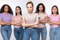Displeased Mixed Women Standing Crossing Hands Disapproving Something Posing Looking At Camera With Serious Expression Over White Studio Background. We Don't Accept It Concept