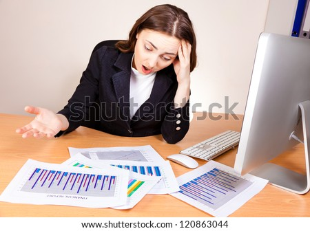 Displeased woman with a financial reports
