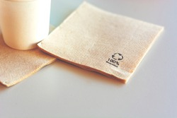 Disposable biodegradable napkin made from recycled paper. Environmental protection and ecology.