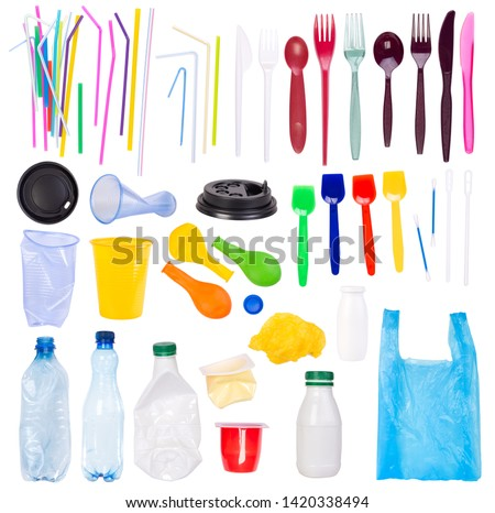 Disposable single use plastic objects such as bottles, cups, forks, spoons and drinking straws that cause pollution of the environment, especially oceans. Isolated on white background. ストックフォト ©