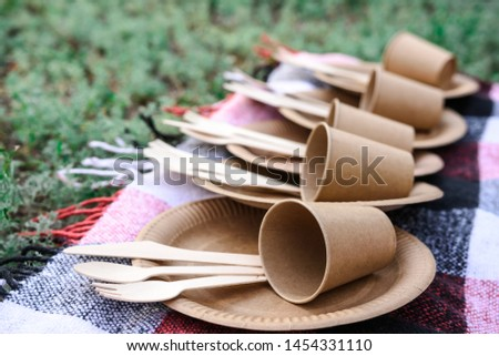Disposable tableware from natural materials, wooden spoon, fork, knife, environmentally friendly. Ecological crockery in nature. Eco picnic. Place for text.
