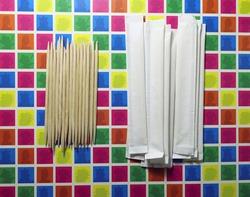 Disposable toothpicks on vivid background