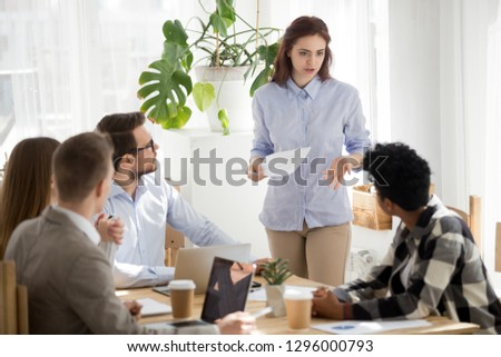 Dissatisfied caucasian employee having disagreement disputing annoyed by african coworker at group meeting, diverse colleagues rivalry, bad team relations and racial conflicts at work concept Stock photo ©