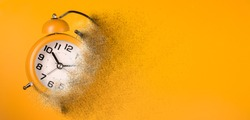 Dissolving orange alarm clock. Dissolving time