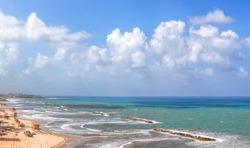 Distance view of Tel-Aviv beaches, Mediterranean sea. Old Jaffa, Yafo ancient city on horizon. Israel