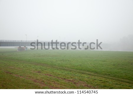 distant bridge over river with fog