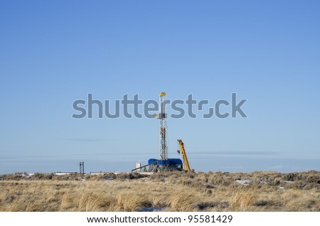 distant drill rig set up for winter drilling in Wyoming