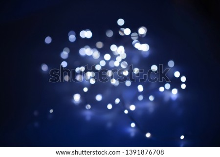Distant illumination light glistening or bokeh abstract. Shallow depth of field for dreamy feel. #1391876708