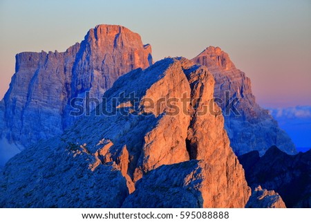 Distant summits and rock walls at sunset, Dolomite Alps, Italy #595088888