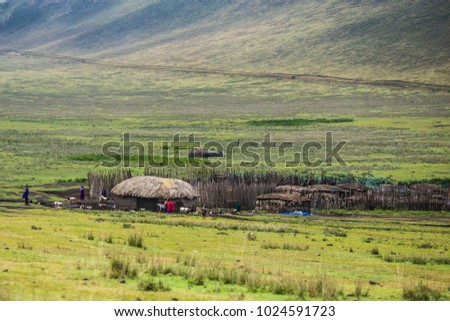Distant view of Masai tribal village at Ngorongoro crater in Tanzania #1024591723