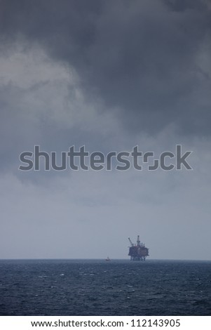 Distant view of oil rig on sea