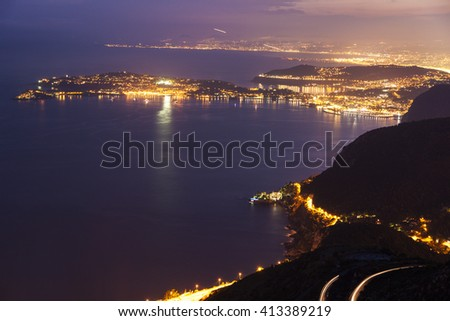 Distant view of Saint Jean Cap Ferrat and Nice at sunset seen from Monaco. Saint Jean Cap Ferrat, French Riviera, France. #413389219