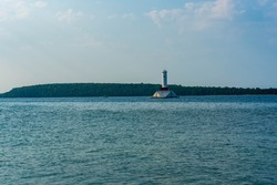 Distant view of the Round Island Passage Light