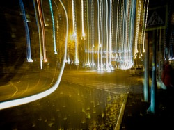 Distorted and glitchy photo of a night street with a lomography effect. Glitch art photo.