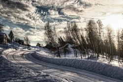 Distorted image of winter road in Swedish Lapland.