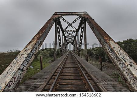 Distorted view of railroad bridge
