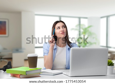 Distracted from work worried young woman sitting with a laptop, thinking of problems.
